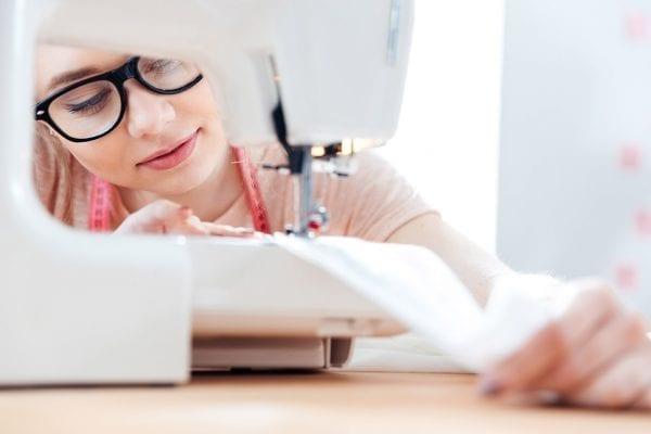 woman using sewing machine